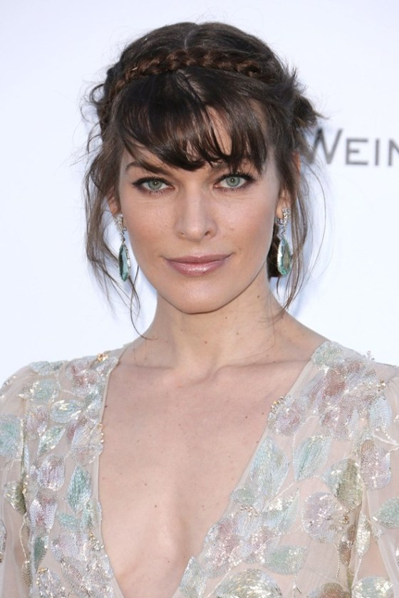 Milla Jovovich looks super sultry with this effortless looking up do